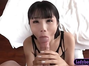 Teen ladyboy with firm tits sucks a huge white penis